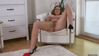 This lady may spread her legs at once to effectively masturbate her furry pussy
