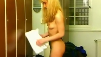 Adorable and thin blond infant masturbating inside the sauna