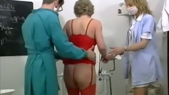 Blond mature girl likes to have spectacular threesome inside the gyno's place of work