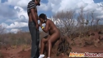 African-american babe eye-catching a pair of prolonged schlongs outside