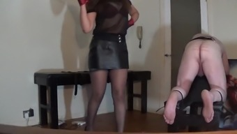 Miss Sultrybelle delivering hard drive data caning.