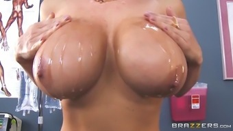 lisa ann pours a large amount of coconut oil through out her impressive boobs