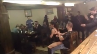 Topless lap-dancer within a bar