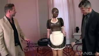 Submissive buxom maid Lucy Latex is gonna please her boss and his perverted partner