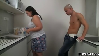 Plus-size woman love-making along at the the kitchen