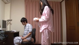 A sweet Japanese people homemaker gives her adult man a handjob