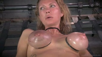 Large breasted mum by using nipple clamps on and gets her muff toyed