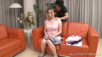 Warm Japanese date gives a blowjob and gets her titties massaged