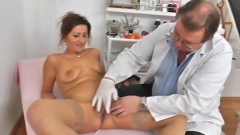 Mature clit assessed by naughty gyno