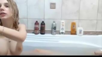 Two youthful lesbians enjoying dildos on tub SexoWebcam.Via the internet