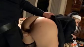 Sexy nun in black stockings fucked via the priest