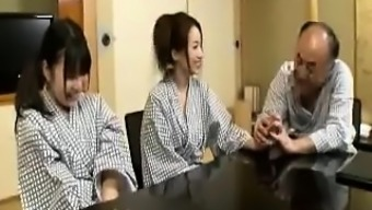 A pair of attractive Japanese people girls take turns kissing and fucking