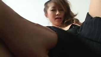 Shrewd Japanese elegance gets her tremendously fuzzy pussy touched by naughty wanker