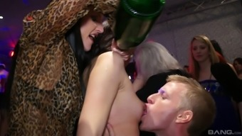 Astonishing beginner porno hotties gives complicated dick a good blowjob in association clubhouse orgy