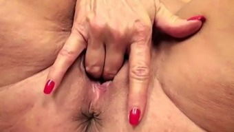 Big tits blond granny hands wrists and fingers her soppy pussy on the ground
