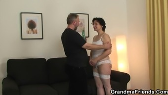 Old girl in white intimate apparel takes it from two sides