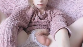 innocent looking blonde tgirl acts her cock