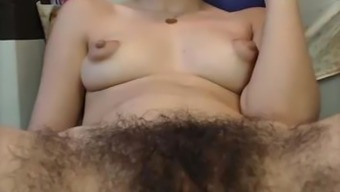 Hirsuite female, puffy nips fingering pussy