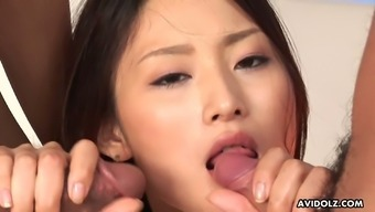 Zealous slender Japanese slut Risa is eager to suck three dicks at once