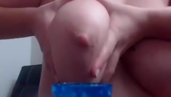 Milking her own great tits on camera