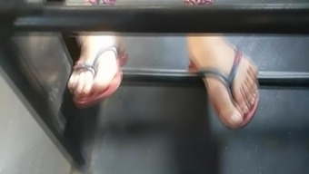 Young adult date both feet on public public bus