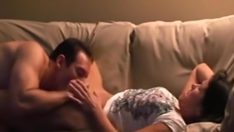 Heated sex with my partner on the couch