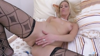 All alone light haired MILF Uma Zex takes off red dress to pet herself