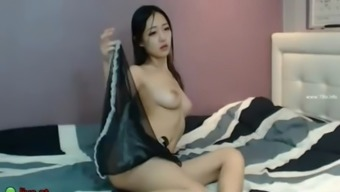 Busty korean model in lingerie masturbates on cam