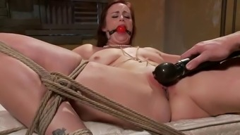 redhead freak is tied to bed with ropes