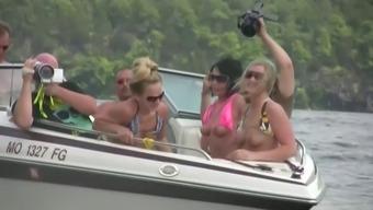 Nasty amateur girls sitting in a boat flash their boobs