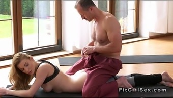 Yoga coach cracks brown from behind