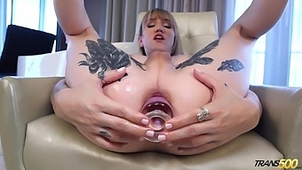 Tatted up tranny Lena Kelly loves anal play and she enjoys jerking off