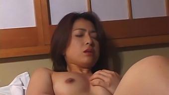 Small tits Japanese girl Kayoko Uesugi gives a nice handjob