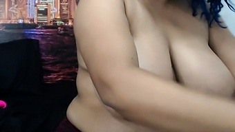 Busty curly brunette with big boobs fucks on couch