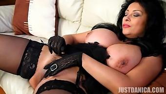 Seductive mature Danica Collins pleasures her cravings on the sofa