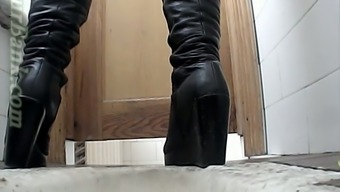 White colored lady in dark colored leather the company pisses inside the wc space on cam