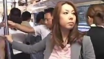 Heated asians making the effort to have sex within the general public shuttle.