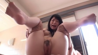 Oriental tramp along with naturally-occuring boobs gives a blowjob and titjob