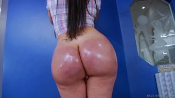 Solo shemale with a big butt stroking her cock and showing her shapes