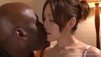 Japanese people hussy gets her pussy laid a hand and torn using a dark colored stud