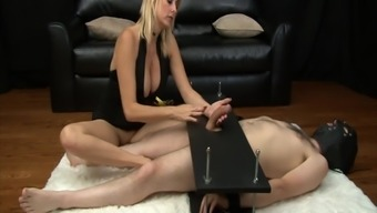 Mean MILF gives mean femdom handjob to actually penis in servitude