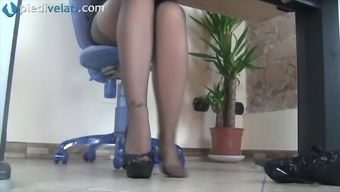 Whilst in the workplace this wayward girl uncovers her fairly both feet