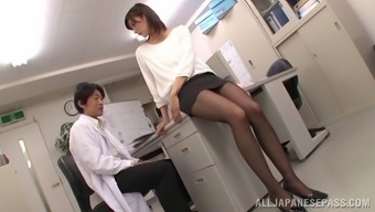 Doctor takes out his cock and the Asian babe blows him